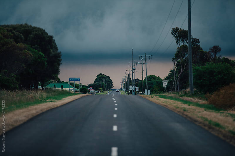 Driving into a storm by Rowena Naylor for Stocksy United