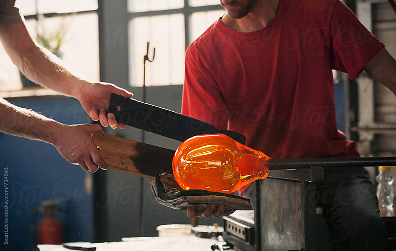 Glass: Artist Using a Pad to Shape Glass by Sean Locke for Stocksy United