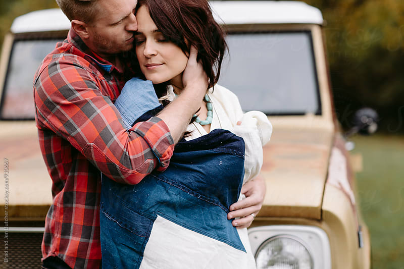 Romantic Couple Embracing  by Brad & Jen for Stocksy United