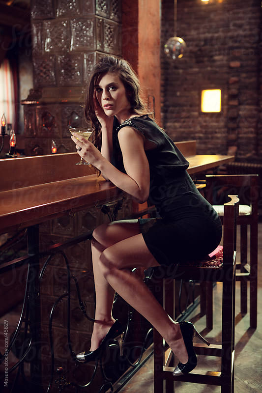 Young woman sitting in the bar. by Mosuno for Stocksy United