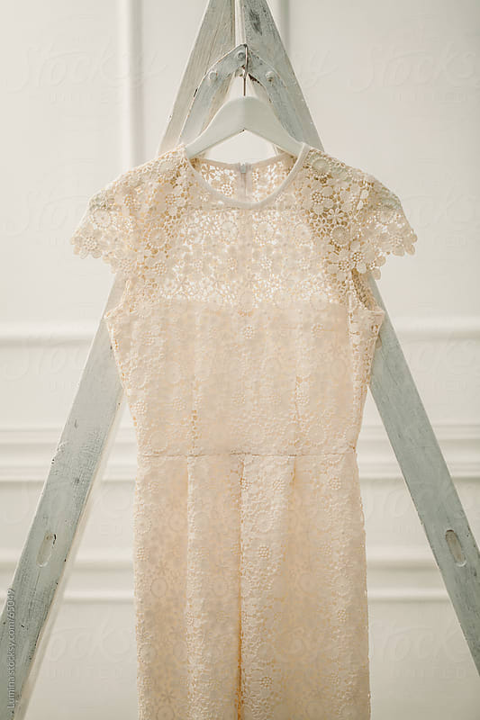 Wedding Dress Hung on a Ladder by Lumina for Stocksy United