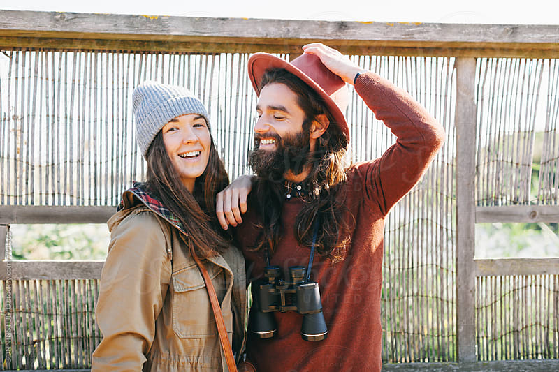 Portrait of hipster couple enjoying a sunny day on a wetland.  by BONNINSTUDIO for Stocksy United