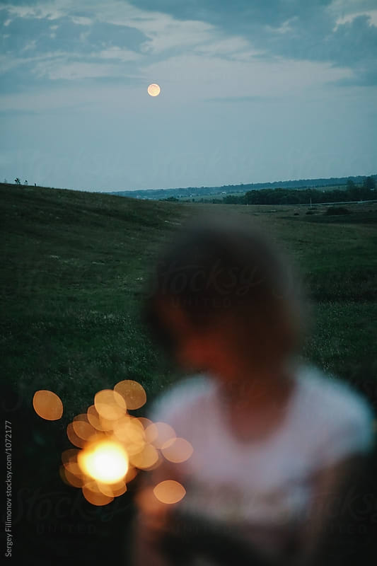 Anonymous girl with sparkler on nature  by Sergey Filimonov for Stocksy United