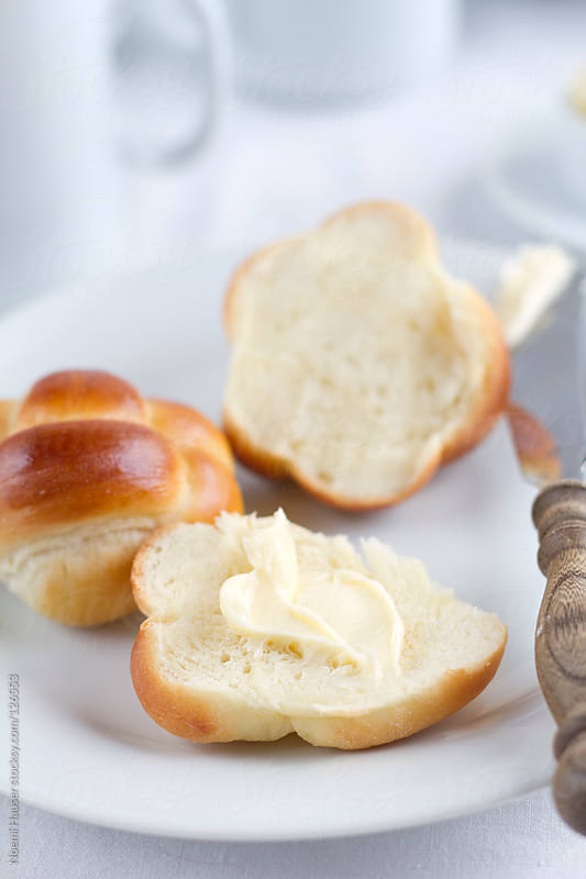 Breakfast roll with butter  by Noemi Hauser for Stocksy United