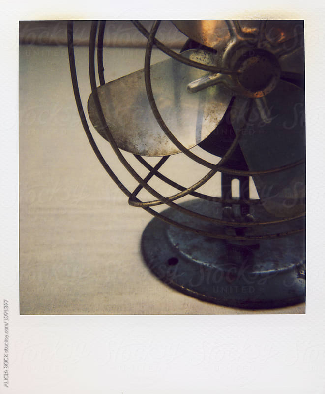 An Antique Fan Photographed With Expired Polaroid Film by ALICIA BOCK for Stocksy United