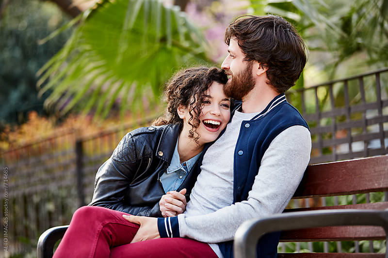 Happy Couple Sitting On Park Bench by ALTO IMAGES for Stocksy United