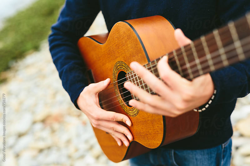 Man playing the guitar outdoors by Good Vibrations Images for Stocksy United
