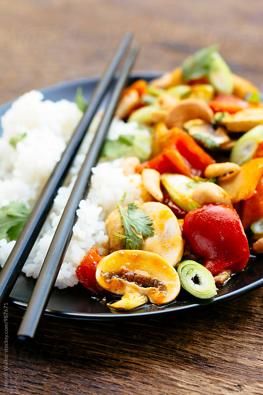 Sweet Sour Pumpkin with Red Bell Peppers and Cashews by Harald Walker for Stocksy United
