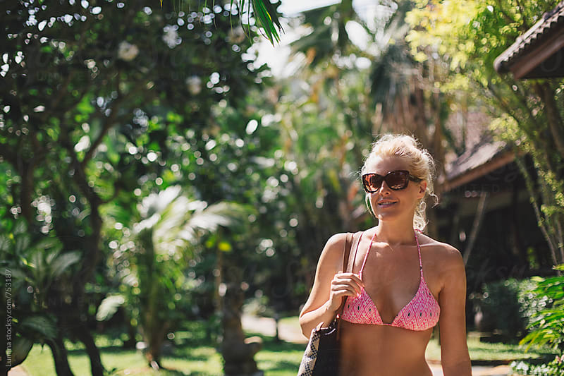 Blonde Woman at a Tropical Resort by Lumina for Stocksy United
