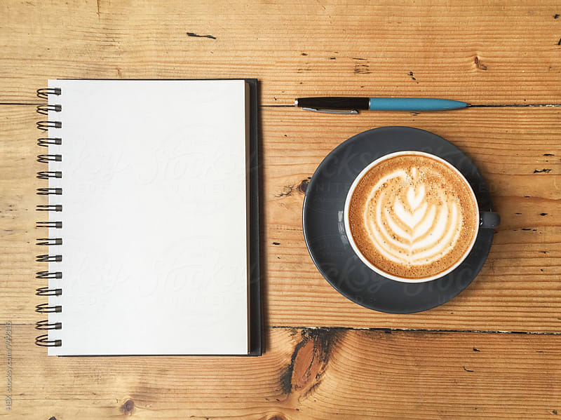 Cappuccino and Note Book with Pen on the Wooden Table by HEX . for Stocksy United