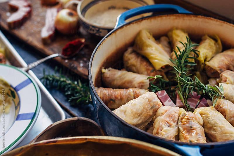 Prepared stuffed cabbage rolls in a pot by Gabriel (Gabi) Bucataru for Stocksy United