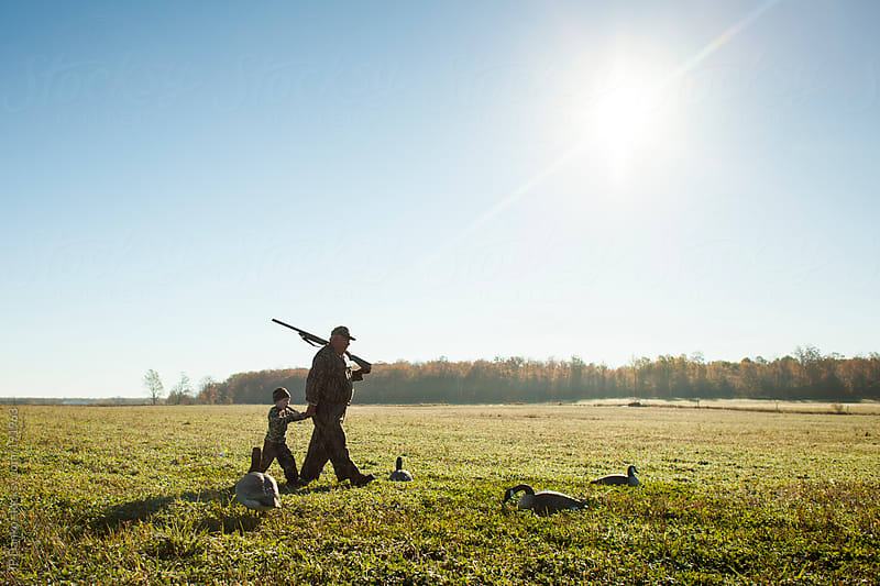 Grandfather Goose Hunting With Grandson in Autumn by JP Danko for Stocksy United