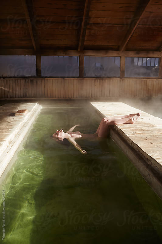 Relaxed woman in water at Japanese spa and hot springs  by Trinette Reed for Stocksy United