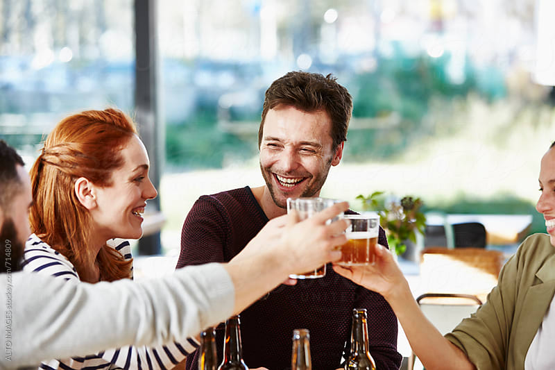 Business Friends Toasting Beer Glasses In Restaurant by ALTO IMAGES for Stocksy United