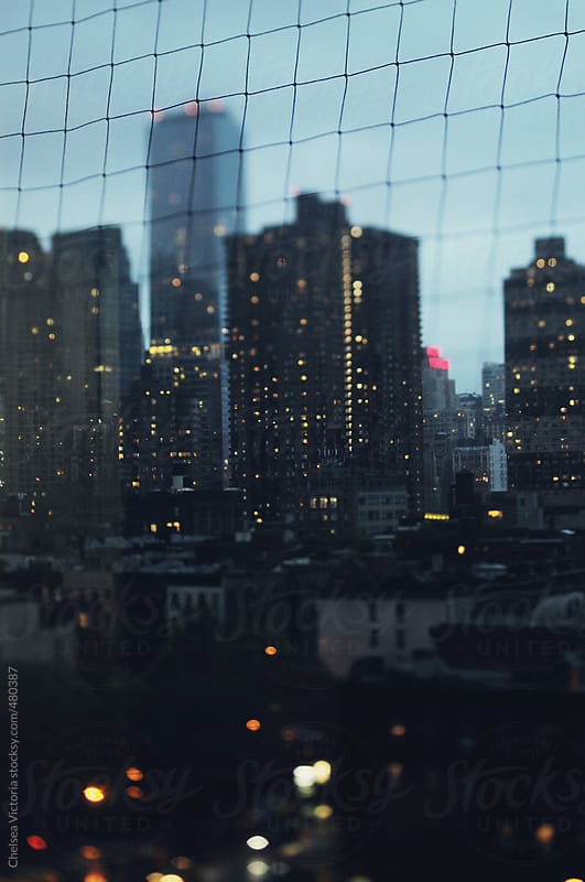 Manhattan skyline on a rainy spring evening by Chelsea Victoria for Stocksy United