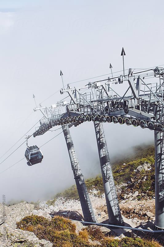 Take the cable car into the clouds by zheng long for Stocksy United