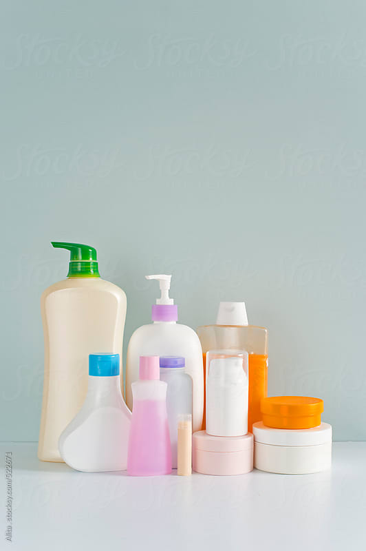 Body care products in colorful bottles by Alita Ong for Stocksy United