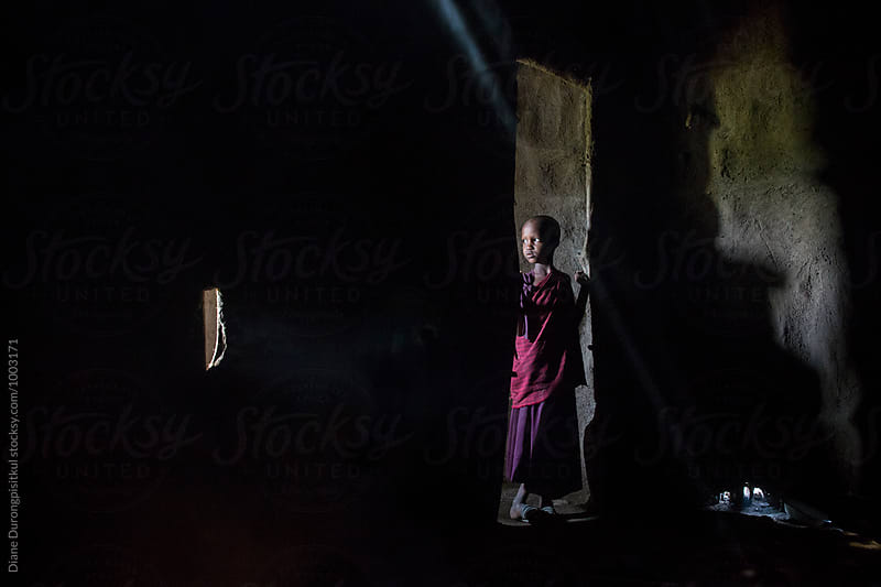 Maasai Girl in the Doorway by Diane Durongpisitkul for Stocksy United
