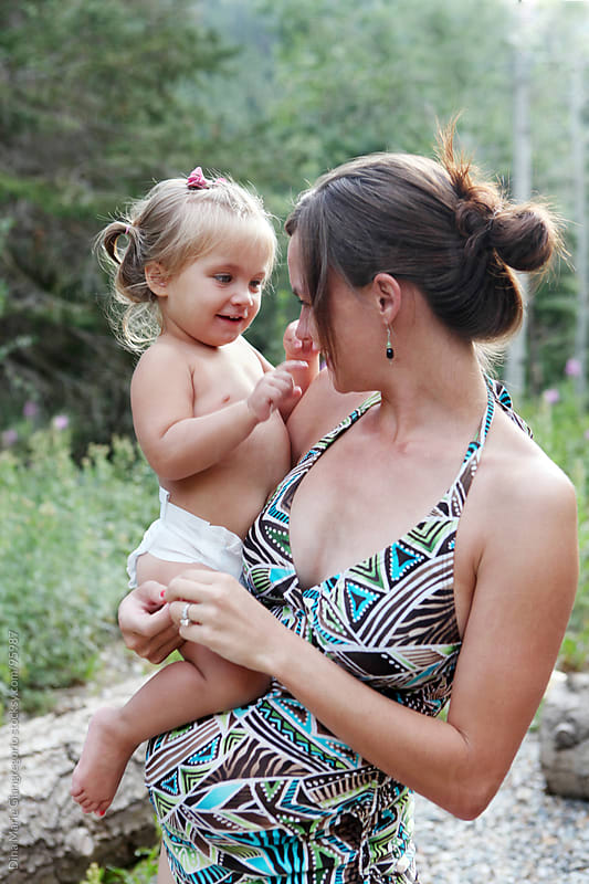 Young pregnant mother holding toddler by Dina Giangregorio for Stocksy United