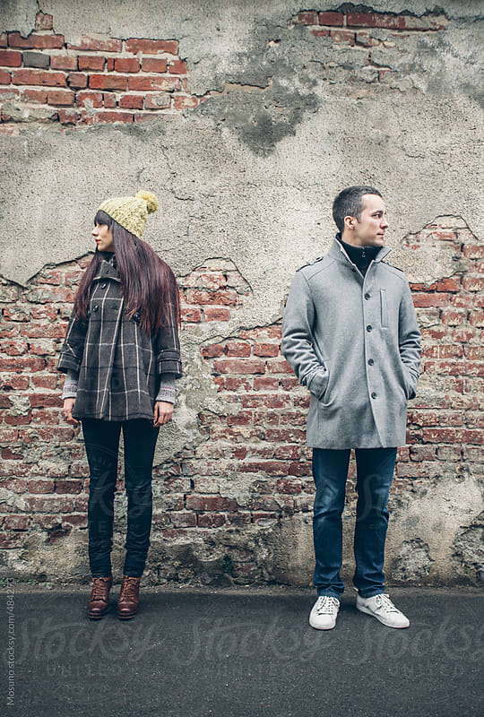 Young Fashionable Couple Standing on the Street  by Mosuno for Stocksy United