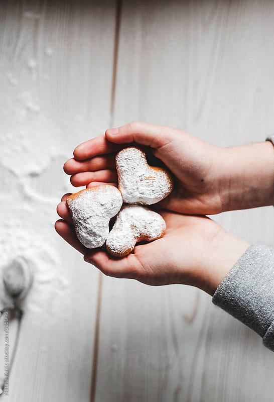 Heart shaped donuts with sifted caster sugar by Natasa Kukic for Stocksy United
