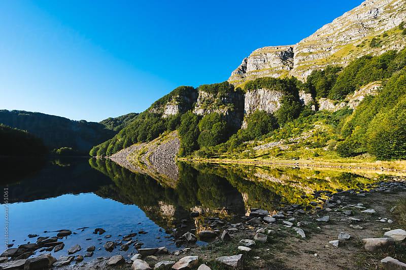 mountain lake  by Juri Pozzi for Stocksy United