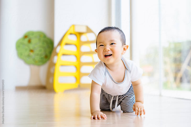 Cute toddler crawling on the floor by MaaHoo Studio for Stocksy United