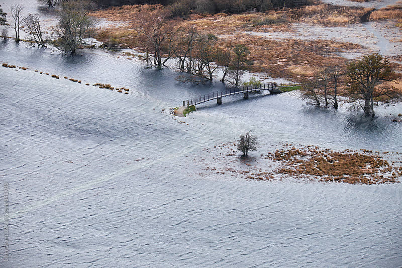 River flooding surrounding land after heavy rain storms in Borrowdale. Cumbria, UK. by Liam Grant for Stocksy United