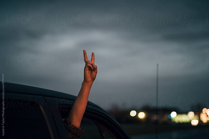 Hand doing peace sign by Isaiah & Taylor Photography for Stocksy United