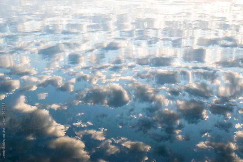 Reflection of morning clouds on the water by Jenny Sathngam for Stocksy United