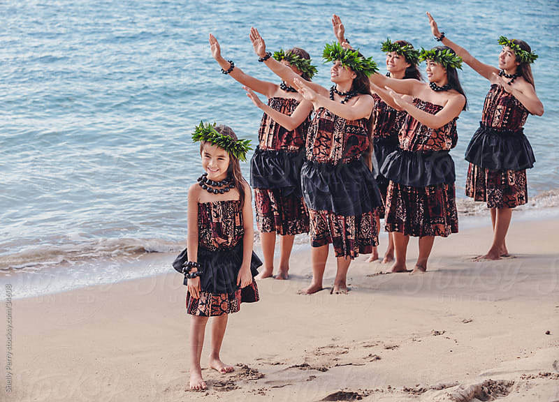 Group of traditional Hawaiian hula dancers performing on the beach in Maui by Shelly Perry for Stocksy United