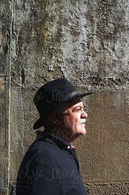 Senior portrait by Jose Coello for Stocksy United