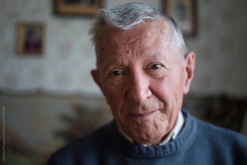 Portrait of a gray haired senior looking at the camera by Jovana Milanko for Stocksy United