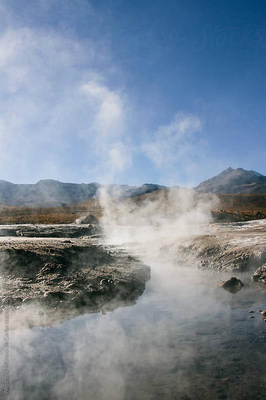Geyser and hot springs with steam in Tatio, Atacama, Chile by Alejandro Moreno de Carlos for Stocksy United
