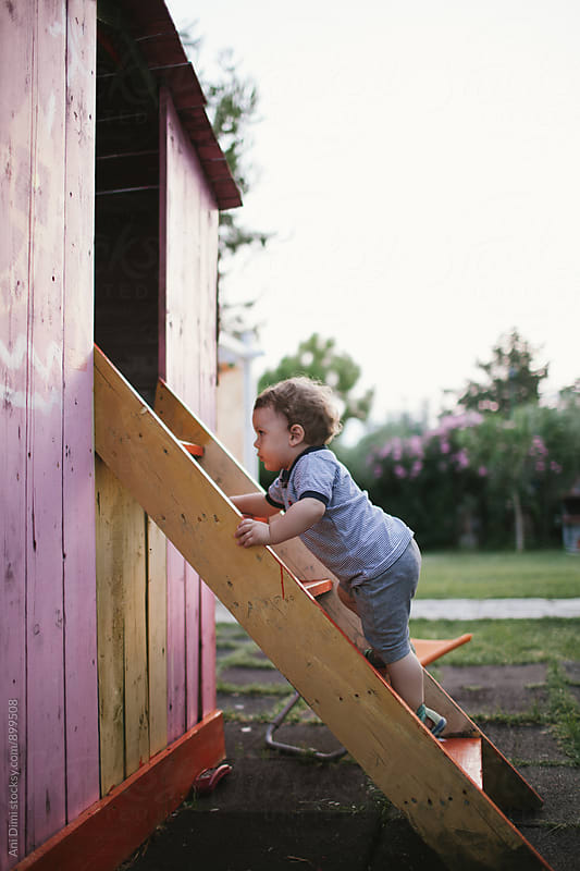 Little boy is playing on a playground by Ani Dimi for Stocksy United