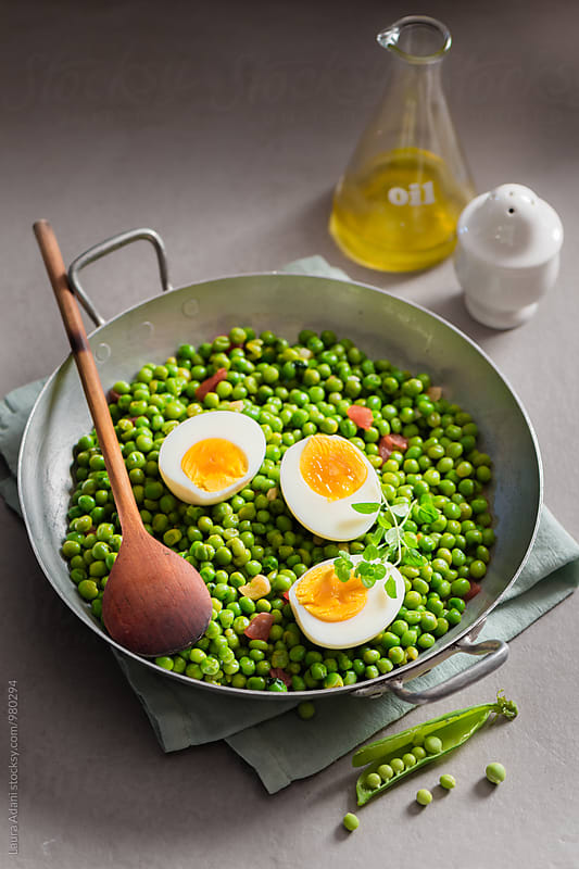 Stewed peas and boiled eggs in a saucepan by Laura Adani for Stocksy United