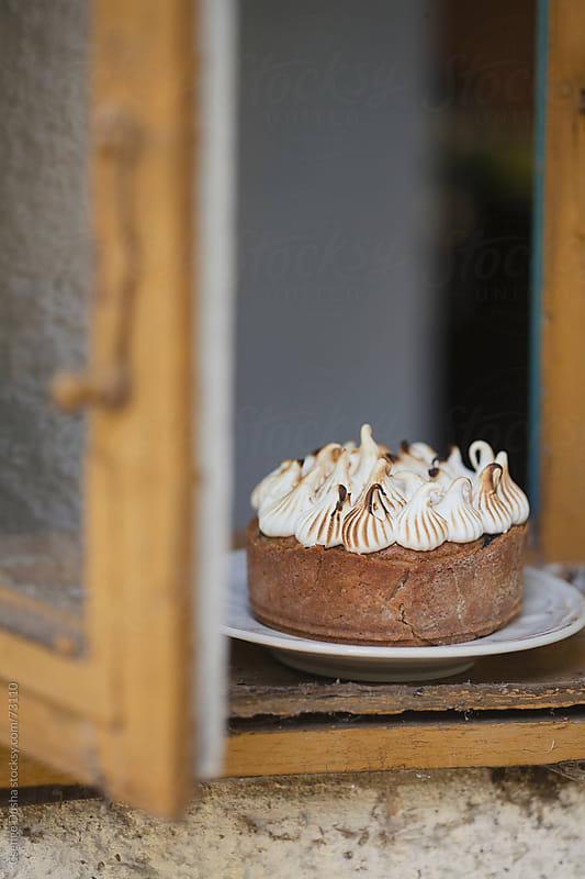Toasted hazelnut meringue cake by Csenge Dusha for Stocksy United