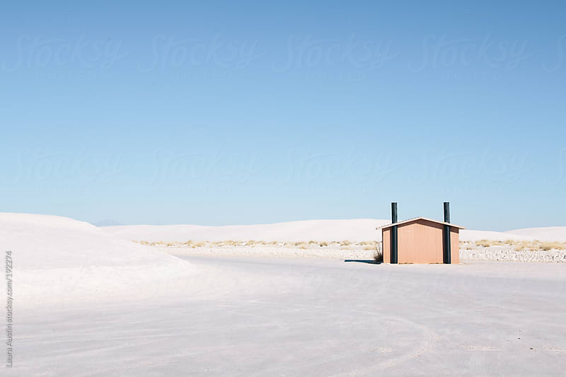 Single Building Sitting In A White Desolate Landscape by Laura Austin for Stocksy United