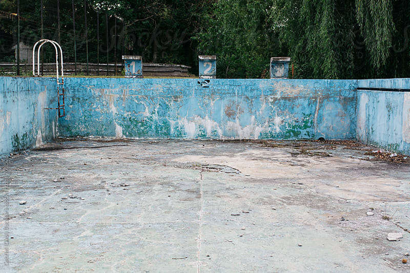Dilapidated swimming pool by Gabriel (Gabi) Bucataru for Stocksy United