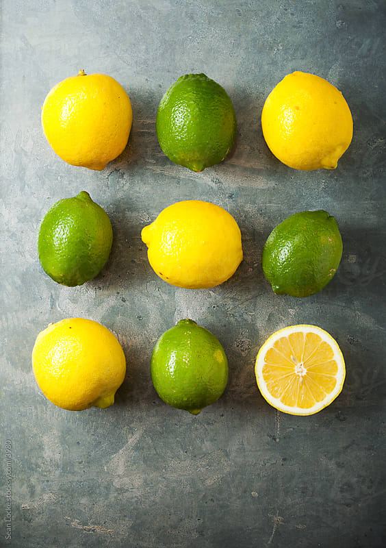 Food: Lemons and Limes on Metal Background by Sean Locke for Stocksy United