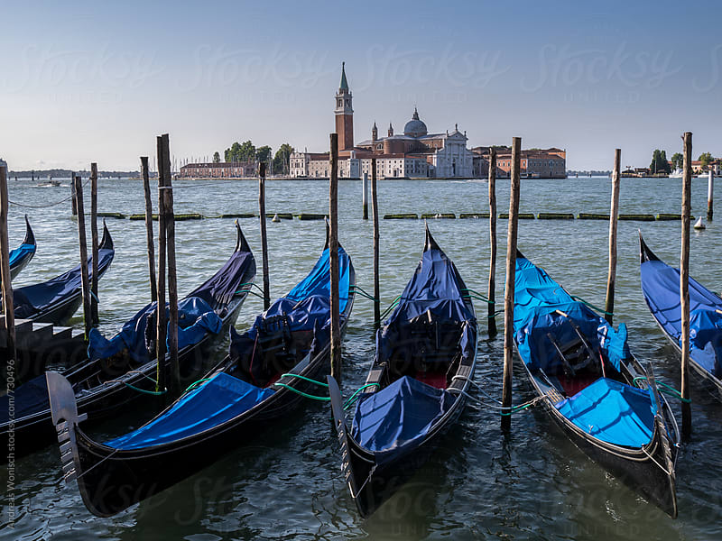 Gondolas in Venice with San Giorgio Maggiore in the Background by Andreas Wonisch for Stocksy United