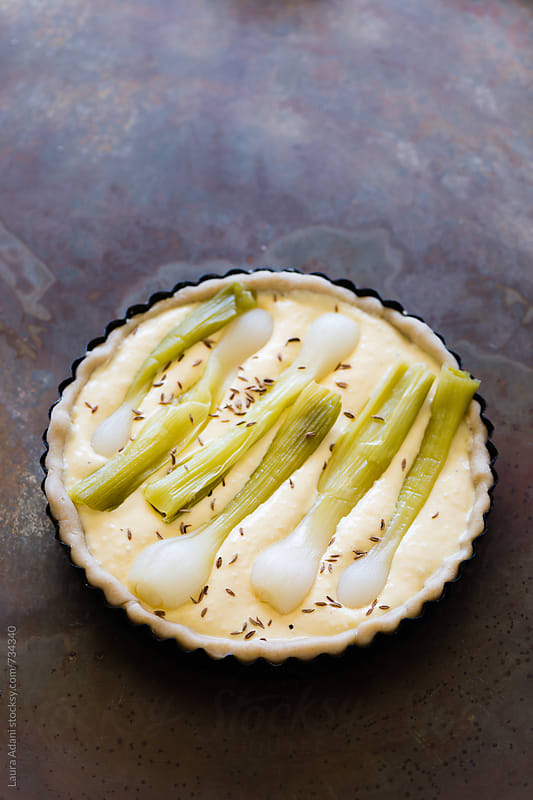 raw quiche with ricotta and green onions by Laura Adani for Stocksy United