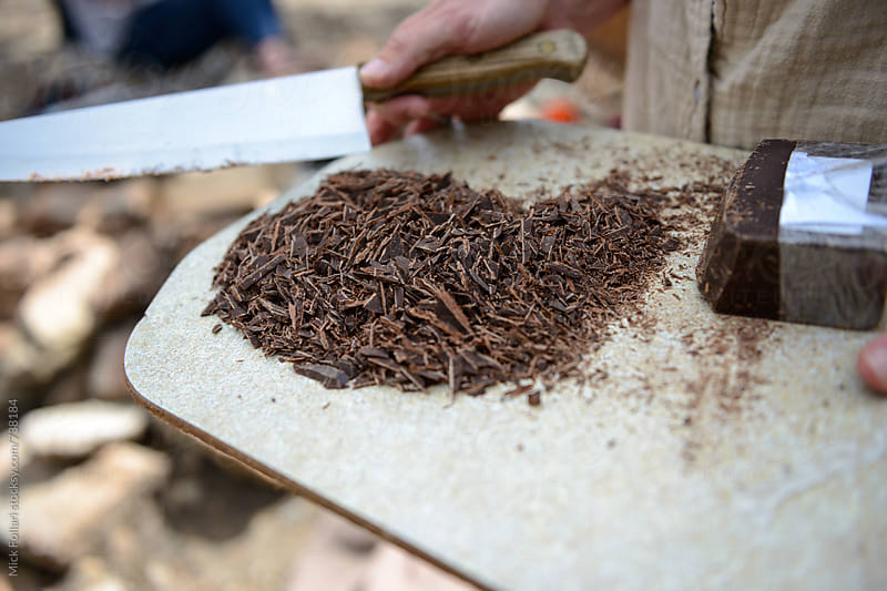 Shavings chopped off a block of chocolate by Mick Follari for Stocksy United