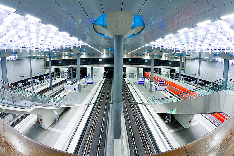 Europe, Germany, Berlin, train pulling into the new modern main railway station - futuristic interior design by Gavin Hellier for Stocksy United