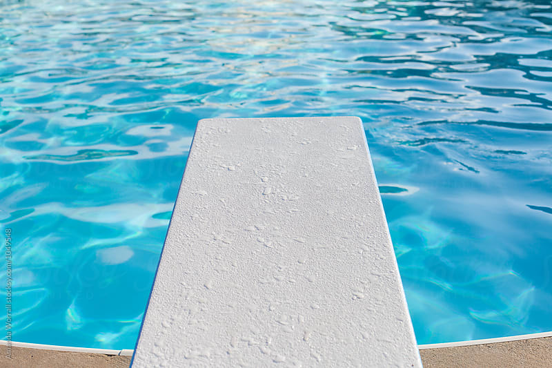 Horizontal view of diving board over a pool by Amanda Worrall for Stocksy United