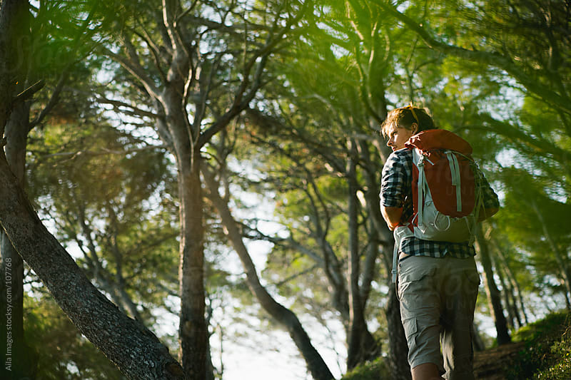 Man Hiking in the woods by Aila Images for Stocksy United