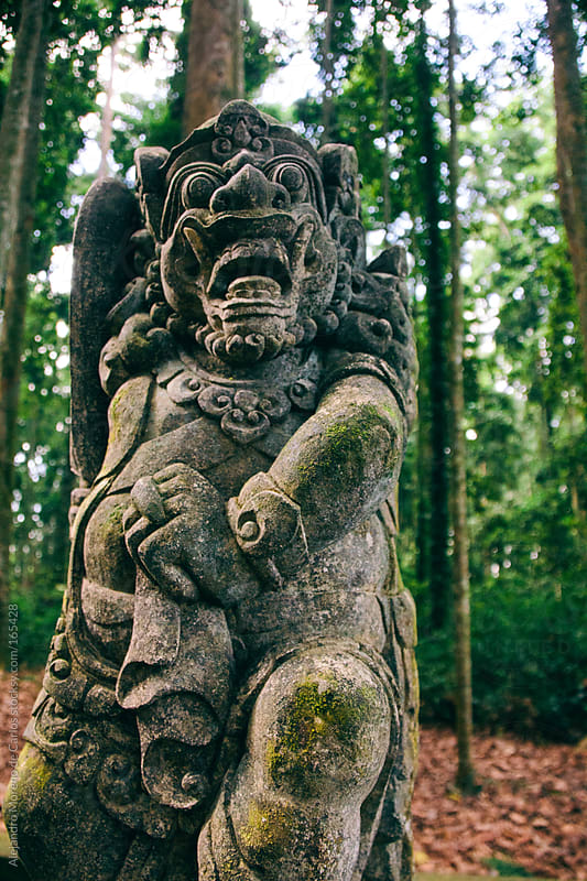 Ancient tribal stone sculpture on Sangeh Monkey Forest, Bali, Indonesia by Alejandro Moreno de Carlos for Stocksy United