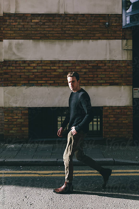 Fashionable Man Walking on the Streets of London by HEX. for Stocksy United