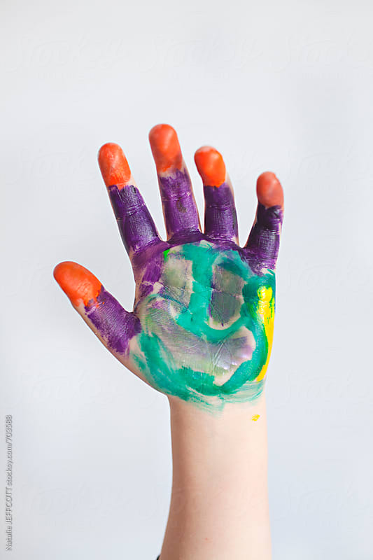 a young child's hand with a face painted on it by Natalie JEFFCOTT for Stocksy United