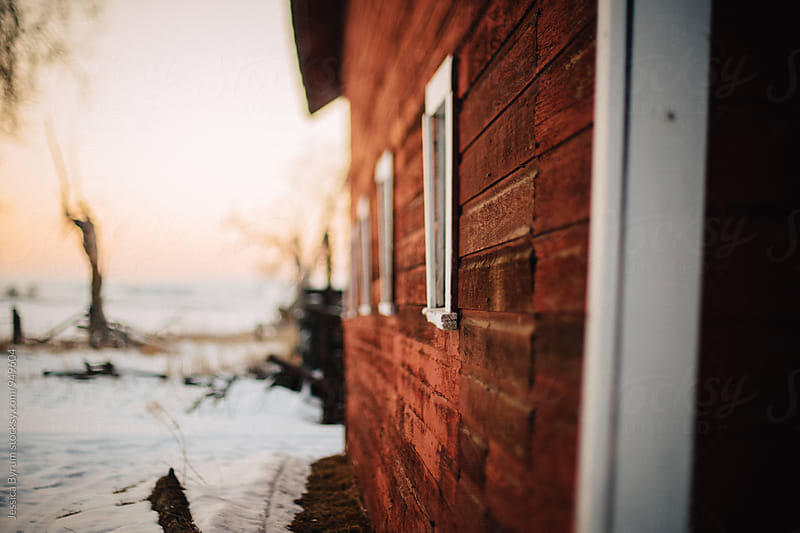 Leaning barn freelensed in winter by Jessica Byrum for Stocksy United